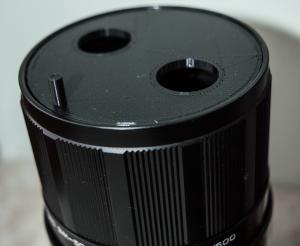 3D-gedrucktes Bauteil am Spiegelteleobjektiv